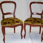 Two balloon chairs reupholstered in a French velvet fabric