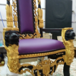 Chair for a promotion reupholstered in Warwick Lustrell